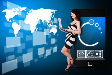 stock broker: Secretary use notebook computer and look at the world map background Stock Photo