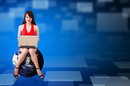 Sexy Secretary sit on earth and use notebook computer Stock Photo - 12995152