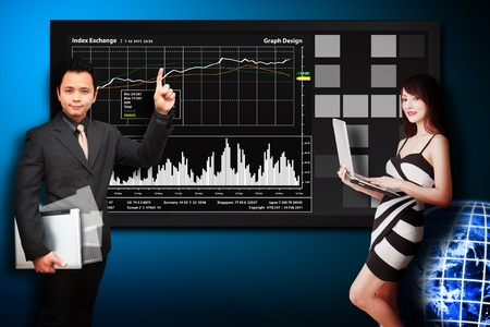 Business man and secretary present the stock exchange graph report  photo