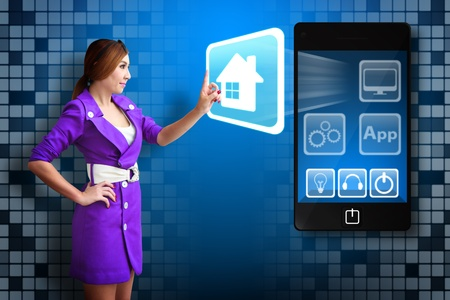 Woman touch the House icon from mobile phone Stock Photo - 12995141