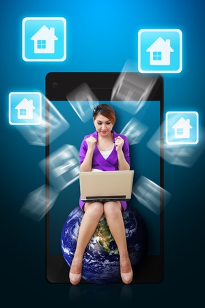Woman on globe and House icon from mobile phone Stock Photo - 12994910