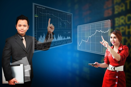 Business man and woman present the Stock exchange graph report photo