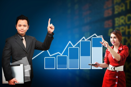 wold map: Business man and woman present the Stock exchange graph report Stock Photo