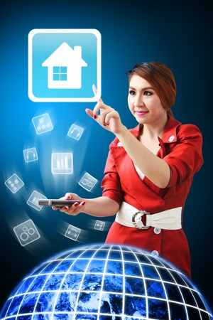 Woman touch the House icon from mobile phone Stock Photo - 12994797
