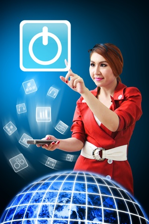 Woman touch the Power icon from mobile phone Stock Photo - 12994665