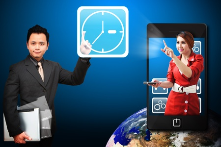 Business man touch the Clock icon from mobile phone Stock Photo - 12994997