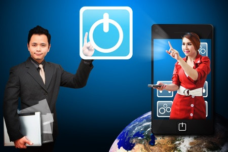 Business man touch the Power icon from mobile phone Stock Photo - 12995047