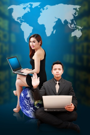 Business man and woman present the stock exchange world map Stock Photo - 12994981