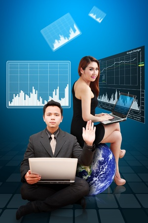 Business man and woman present the Graph report photo