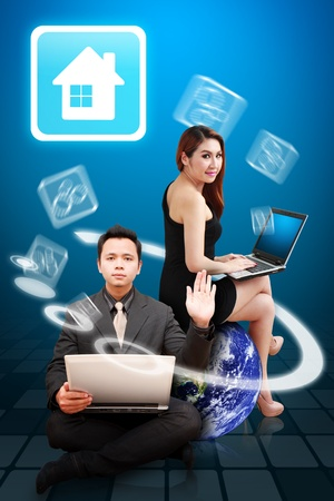 Business man and woman present the House icon Stock Photo - 12994626