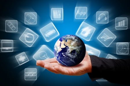 Smart hand hold the world of icon Stock Photo - 13627695