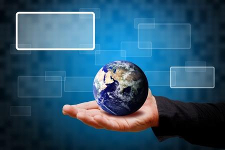 hand holding globe: Smart hand hold the Tiny globe