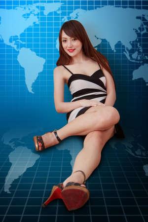 wold map: Beautiful woman on World map background  Stock Photo