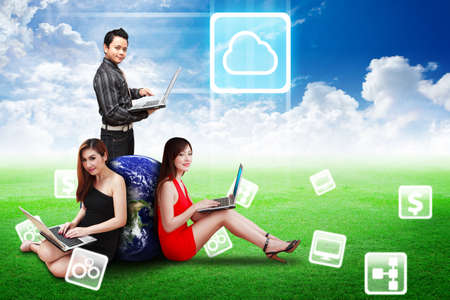 cloud storage: A group of business team present the Cloud icon on the blue sky on grass field Stock Photo