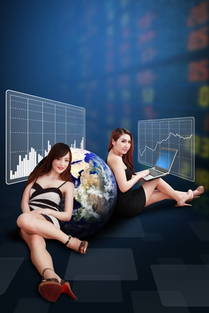 wold map: Two lady present the stock exchange graph report