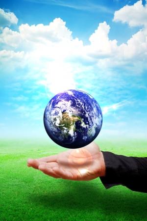 Smart hand help the world Stock Photo - 13635825