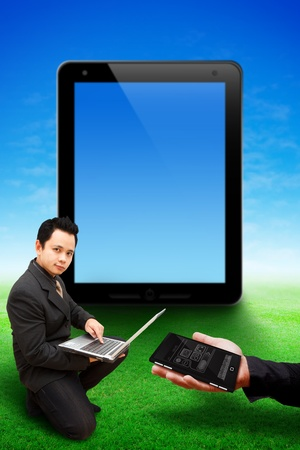 Business man and tablet computer background photo