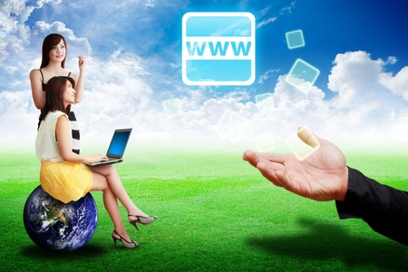 Two lady look at the WWW icon from business man on grass field Stock Photo - 13645105