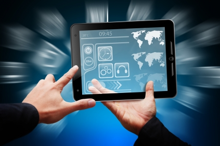 Smart hand touch on tablet computer and digital layout  photo
