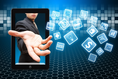 Business man give the Application icons from touch pad  Imagens