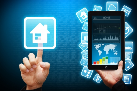 smart home: Smart hand press on house icon from mobile phone  Stock Photo