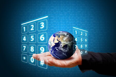 dial pad: Smart hand hold the Earth and Dial pad number Stock Photo