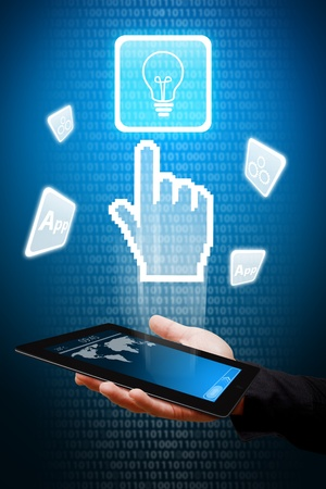 Digital hand from touch pad point to Light Bulb icon  photo