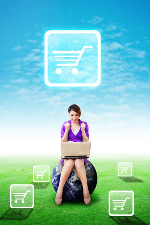 Woman on globe present the Cart icon on the blue sky and grass field photo