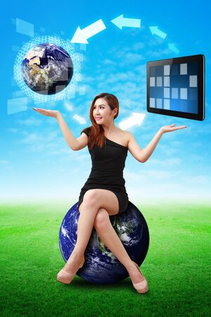 Lady on globe hold the world and touch pad photo