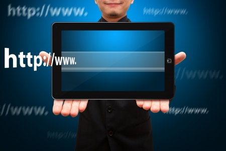 Business man hold touch pad and Website address photo