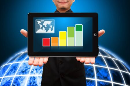 Smile business man hold digital touch pad and Graph report photo