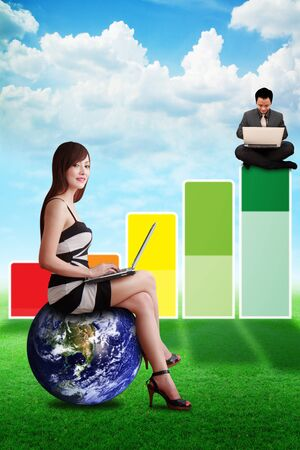 Business man and woman on Bar graph on the grass field  Stock Photo - 14009283