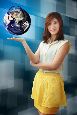 Smile lady hold the digital world photo