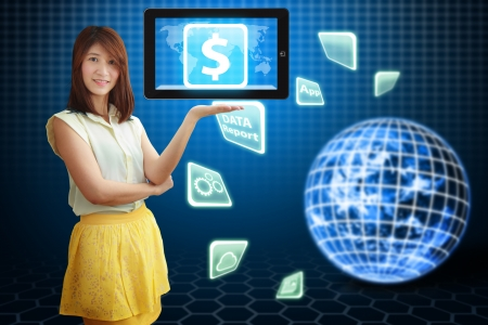 Smile lady hold the Money icon on touch pad photo