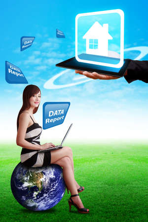 House icon on touch pad and lady on globe photo