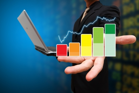 Business man hold the graph report on hand Stock Photo - 14396288