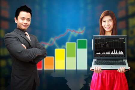 Business man and woman show the graph  photo