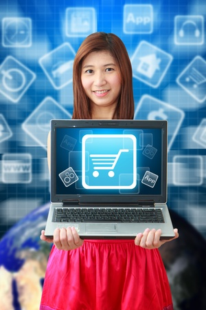 Smile woman and Cart icon on notebook computer Stock Photo - 14364475