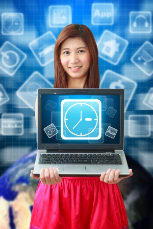 Smile lady and Clock icon on notebook computer photo