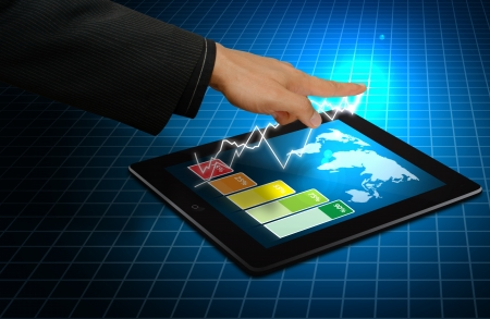 Digital touch pad and graph report Stock Photo - 14396386