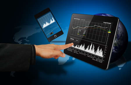 Digital touch pad and graph report Stock Photo - 14396316