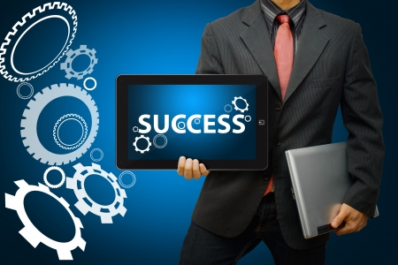Businessman and gear to success photo