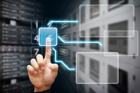 web host: Smart hand touch on power button in data center room Stock Photo