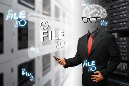 Genius programmer keeping data file in Data center room  Standard-Bild