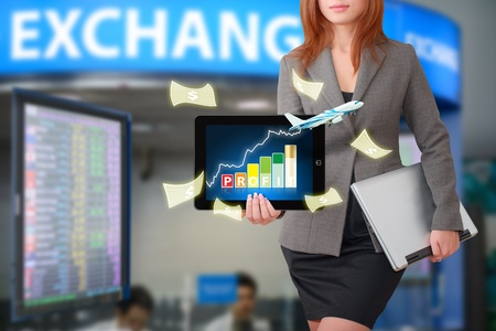 Business woman with graph report for exchange rate Stock Photo - 15668387