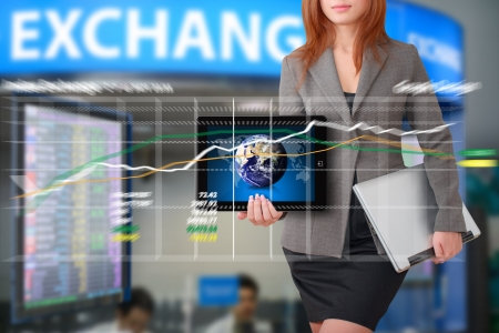 Business woman with graph report for exchange rate Stock Photo - 15668331