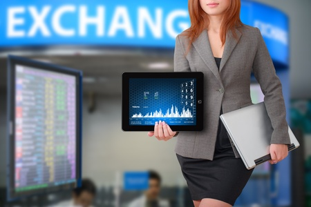 Business woman with graph report for exchange rate Stock Photo - 15668389