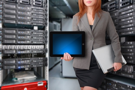 computer programmer: Programmers in data center room and digital tablet for present  Stock Photo