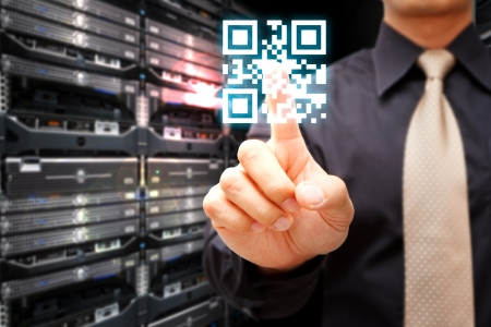 qr: Hand press on QR Code Stock Photo