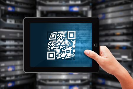 Tablet and QR code in data center room photo